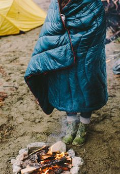 I don't see how this isn't just perfect: wrapped in a sleeping bag, green boots and a nice fire... Bet my love is behind the camera: perfect!
