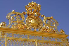 Golden gates from the Palace of Versailles