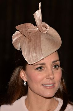 Catherine, Duchess of Cambridge debuted this smokey pink teardrop hat as she attends the Observance for Commonwealth Day Service at Westminster Abbey on March 9, 2015.  The hat was created specifically for Kate by Jane Taylor made of pink straw with twisted straw embellishment.