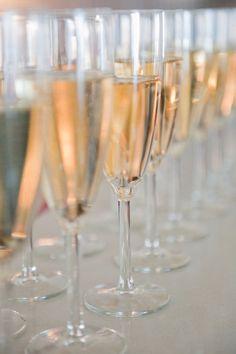 The champagne toast in elegant crystal flutes: an eternal wedding tradition. #TiffanyPinterest #TiffanyWeddings