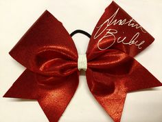 JUSTIN BIEBER SIGNATURE BOW!! Part of Primacy Cheers's Justin range! www.primacycheer.com Justin Bieber Signature, Justin Bieber Outfits, Fabric Bows, Cheer Bows, Cheerleading, Range, Handmade, Clothes, Outfits