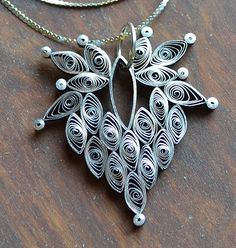 Quilled Pendant (I must convince my mom to make this for me).