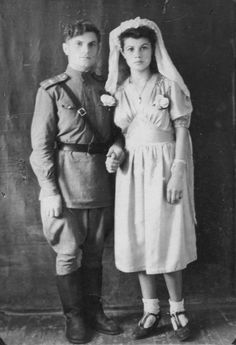 Wartime romance... bride (wearing bobby socks) and groom (in uniform).