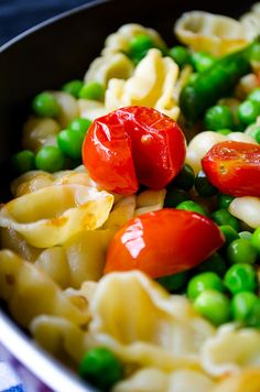 Healthy and tasty summer pasta with cherry tomatoes and fresh peas ...