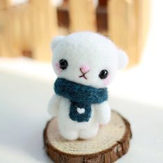 Design: Needle felted Animal Scarf CuteBear In Stock:2-4 days for processing Include: Only The Needle FeltingBear Color: White Material: Felt Wool (100% merino wool), Plastic Eyes, Love Size: 7cm(H) x...