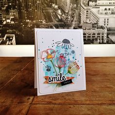 "Make You Smile Card. Cardstock: PaperProducts; DP: Basic Grey (""June ""Bug"");  water colours: Schmincke; stamps: Penny Black (""Touch of Whimsy""), We R Memory Keepers (""Hello"" set); dies: SimplyGraphic (""Fleurs d'Été""); ink: Ranger, SU; DYMO tape."