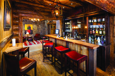 Big Sky Journal - The Whalen's desire for a lodge-like feeling is accomplished through multiple gathering spaces, including a bar for après ski drinks right by the slopeside door.