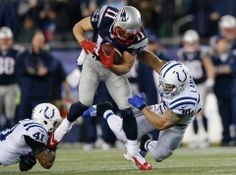 New England Patriots wide receiver Julian Edelman (11) runs between Indianapolis Colts safeties Antoine Bethea (41) and LaRon Landry (30) during the first half of an AFC divisional NFL playoff football game.