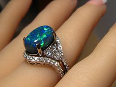 Black Opal and Diamond Engagement Ring made in Platinum with two custom wedding bands made to fit.