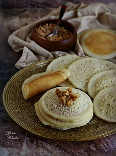 Qatayef,Atayef a middle eastern stuffed pancakes,There is Something wonderful about dishes that are only served in special occasions, and one of those are Atayef or Qatayef :) when we say Ramadan, then it's Qatayef! as they are Ramadan stable dessert. Ramadan Desserts, Ramadan Recipes, Middle East Food, Middle Eastern Recipes, Palestine Food, Sweets Photography, Vegan Junk Food, Arabian Food, Mediterranean Dishes