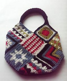 Crochet Bags Nordic Inspired Bag -free crochet pattern- - A few things about this crochet bag caught my attention! The designs in the squares are pretty cool for one, I love Nordic patterns. The squares themselves are easy to assemble with a little bit of Crochet Jumper Pattern, Crochet Purse Patterns, Crochet Handbags, Crochet Purses, Crochet Bags, Love Crochet, Knit Crochet, Crochet Skull, Sac Granny Square