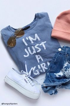 """A knit tee featuring a round neck, short sleeves with slight distressing, a faded front """"I'm Just A Girl"""" graphic, and a subtle acid wash."""