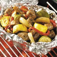 Sausage Veggie Grill Recipe -With sausage, fresh veggies and herbs, this pouch of summer flavors is as colorful as it is bursting with flavors. It's very easy and yummy for a summer get-together on the patio! —Laura Hillyer, Bayfield, Colorado