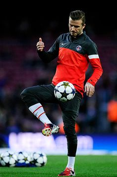 David Beckham warms up on the pitch ahead of kick-off. He starts on the PSG bench