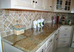 Persian Brown granite countertop with Noce travertine tumbled stone backsplash