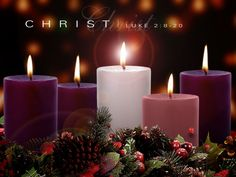 The purple candles represent royalty.  The pink symbolizes joy.  The white candle in the center, the Christ candle,  represents purity.