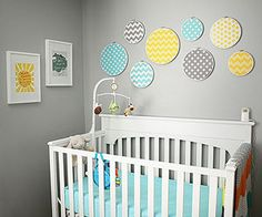 Cool and Subdued: Stephanie Avey knew she wanted white furniture to go with her gray nursery. She added yellow and teal to the color palette and came up with this eclectic room for her baby son.
