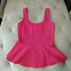 Bebe Pink peplum XS tank Bebe pink peplum tank. Bright deep punk color. Pics are true to size. Size XS. Thick straps and stretchy form fitting material to accentuate curves. Never worn! Retails for $49 selling for $25. Will accept offers and bundles. bebe Tops Tank Tops