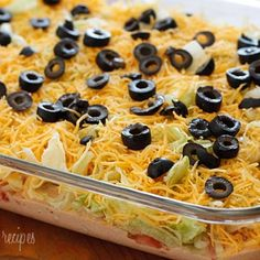 Skinny Taco Dip     8 oz 1/3 less fat Philadelphia cream cheese     8 oz reduced fat sour cream     16 oz jar mild salsa     1/2 packet taco seasoning     2 cups iceberg lettuce, shredded fine     2 large tomatoes, seeds removed and diced     1 cup reduced fat shredded cheddar cheese     2.25 oz sliced black olives