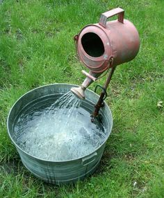 "French Farm, a very eclectic and interesting garden property in Greenwich, CT. Cool little watering can fountain. Yup, it's just a few found or reclaimed objects like a galvanized tub and watering can with a simple pump that recirculates the water creating a ""fountain."""