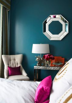 I would love an accent wall, but I don't want the room to get too dark.  Also, I like the pops of color here.  That's not exactly the shade of purple I would do, but I think dark teal and purple can work together.  I still like yellow, but I like that orange against the wall too.