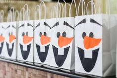 Olaf party bags at a Frozen birthday party! See more party planning ideas at CatchMyParty.com!