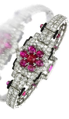 A 1925 Cartier ~ bracelet of ruby, onyx and diamonds in an exquisite Art Deco design.