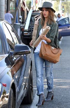 Denim queen Jessica Alba perfected the blue jean staple a long time ago. She mastered the perfect end-of-week style by wearing her torn pair with ankle boots, an army-colored jacket, and a fedora.