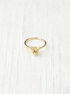 I mean...obviously I'll be needing this ASAP....Verameat Cheshire Kitty Ring at Free People Clothing Boutique