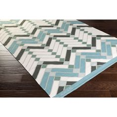Bold and inspiring, the beautiful contemporary design of this rug are sure to add something new and fresh to any decor with hues of teal, ivory and forest.