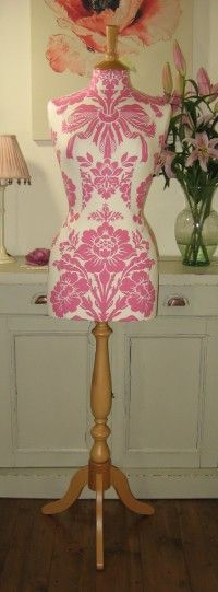 Shown below in cerise (cotton/linen mix) size 10/12, with corset laced back and natural beech stand.