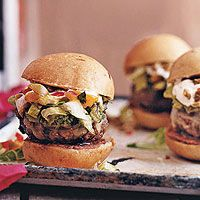 Based on the classic Tex-Mex 7-layer party dip, these spicy beef sliders are only a couple of inches wide, but stack up high.