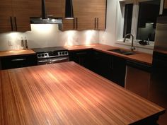 beautiful bamboo vertical amber kitchen countertop finished with mineral ol