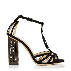 Geometric Heels make a thing of beauty out of lines and angles. Their hollow geometric block heel and rectangular T-bar are irresistibly chic. In black suede, this pair is a high-fashion finish to any look.