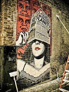 shepard fairey- What if we do a brick wall in VIP in a vintage style graff, of some vintage airplane advertising or such?