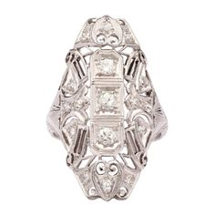 Diamond Pierced Platinum Dinner Ring | From a unique collection of vintage cocktail rings at http://www.1stdibs.com/jewelry/rings/cocktail-rings/