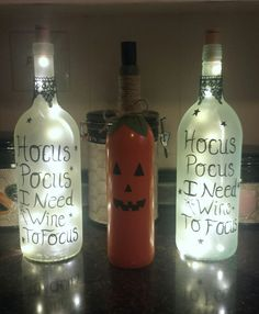 """My latest wine bottle craft, the idea I had found from another Pinterest post. Frosted glass with wine bottle cork lights, illuminates and has a cute saying  """"Hocus Pocus I need wine to Focus """""""