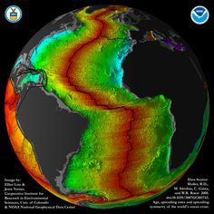 More beautiful symmetry. In black and red, the Atlantic ocean floor is youngest at the center, and oldest (light blue) along the edges of the continents. The Atlantic is opening at about the same rate your fingernails grow. The image is by NOAA.
