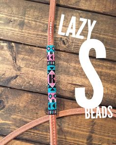 This is a custom beaded Over and under whip. It is a custom order so the design and color options are unlimited. This is handmade and I use only the best materials so your whip will be made to last. I can also make belts, horse tack, headbands, bracelets, dog collars, etc....Contact me for all your personal beading needs. When ordering please send the details of what you want along with the order.