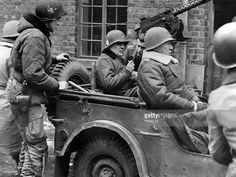 Lt, Gen, George S, Patton Jr (seated in jeep, right) and Brig, Gen Anthony Mc Auliffe start on an inspection tour of the 1O1st US, Airborne Troops who held Bastogne(Belgium) for ten days against enemy attacks (December 29, 1944).