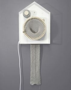 Knitting clock  http://www.fastcodesign.com/1662601/infographic-of-the-day-clock-knits-time-into-a-scarf#