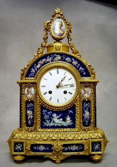 What are antique French mantel clocks?