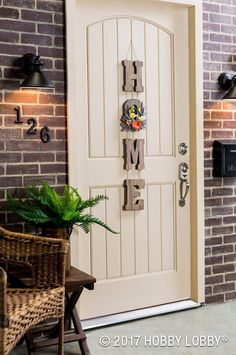 Painted letters are the cure for a dull doorway. Update yours now: 1) Paint letters with equal parts glaze and paint. 2) Drill holes in each letter and tie together. 3) Add faux floral.