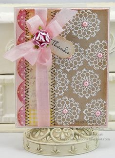 pretty! Love the while doilies on kraft with the pink.