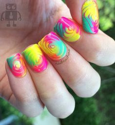 Get your swirls round and round! Choose the most eye popping colors you have and try to do this trick.