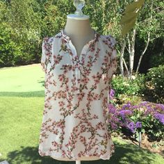 Adorable Floral Top a little see through, super cute. make me offers, no trades Tops