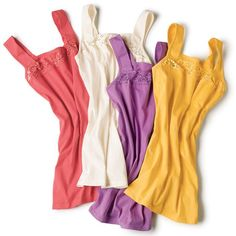 """Keep it simple with this pack of four camis with wide, bra-friendly straps in spring fresh colors (coral, ivory, purple and yellow).· Body: 60% Cotton, 40% Polyester· Lace: 88% Nylon, 12% Spandex· Length from center back/neck: 20-1/2"""" (medium); 21-1/2"""" (x-large)· Wash before wearing. Machine wash cold on gentle cycle with similiar colors; do not use chlorine bleach, use only non-chlorine bleach, if needed. Tumble dry low; remove promptly; cool iron as ..."""