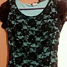 Mint colored lace top This is a mint colored top with a black lace floral design over it. Ruffled bottom and very comfortable. Worn a bit, but in great condition just doesn't fit anymore. Updated pictures others were very blurry. Tops Blouses