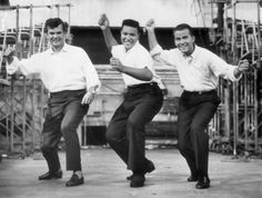 """Chubby Checkers teaching Dick Clark and Conway Twitty how to do """"The Twist"""""""