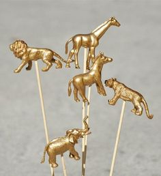 Gold animal drink stirrers ($5.50 for a package of 12) - DIY by painting these animals gold (using gold spray paint) and glueing to cocktail picks